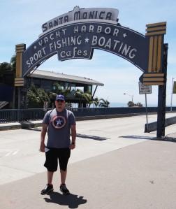 Cameron at Santa Monica Pier Sign